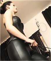 Another harsh caning, delivered by Domina Liza, dressed in jodhpurs.