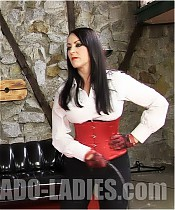 Two cruel riding ladies have fun whipping a slave very hard.