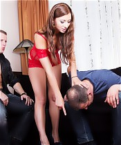 Lustful brunette pushes her husband down sits on his neck and sucks her lover's dick