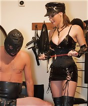 Dominatrix Annabelle's slave is abused and forced to cum on her leather boots