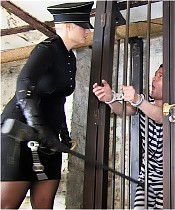 Two prisoners are interrogated by a cruel female officer.