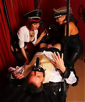 Dominatrix Annabelle and Mistress Lola subject Hobson to some hotwax and the pin wheel