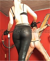 Arrogant young lady punishes a slave with a whip