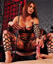 Mistress Carly is not pleased with her submissive and decides to punish his cock and balls with her foot.