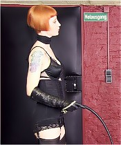 A harsh whipping of a slave by Domina Liza, who is dressed only in lingerie.