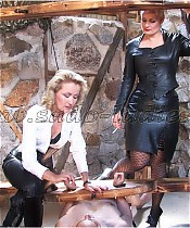 Two Mistresses in leather abuse a slave
