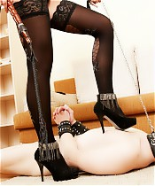 Careful young sub worships every inch of his domme's long nylon-clad legs