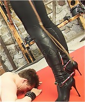 English riding Mistress gives her stable boy a severe whipping