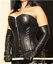 Mistress Ezada, dressed in black leather, makes three slaves suffer from and for he