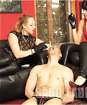 Two young Mistresses and their human ashtray boy.