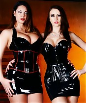 Amazon Mistresses Alexis Grace and Alison Tyler tower over their slave boys and control them by their balls.